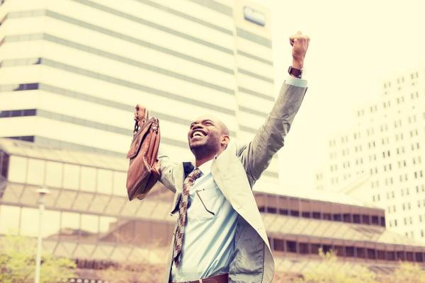 A businessman celebrating